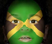 Flag face. Jamaican flag painted on face of child.